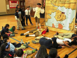 Freedom Trail workers and students re-enact the Battle of Bunker Hill.