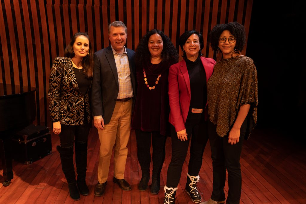 Panelists pose after the conversation.