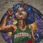 "Detail of the basketball player in Problak's  ""Breathe Life"" mural at Madison Park High School. (Robin Lubbock/WBUR)"